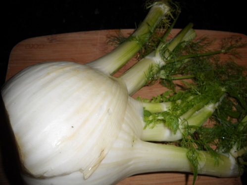 What a piece of whole fennel looks like.. side note.. this has a HUGE fennel bulb (the white part)