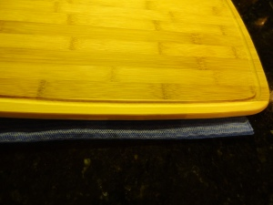 Make sure to place a damp cloth under your cutting board so that it does not slide around while you are cutting